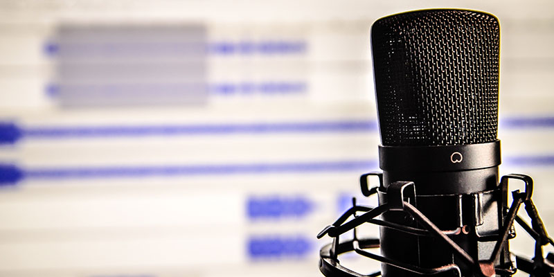 Podcasting - Photo of Microphone in front of podcasting software