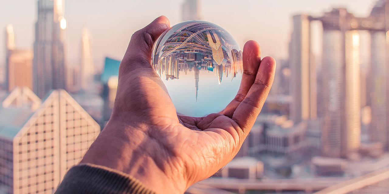 Cityscape reflected in a glass ball