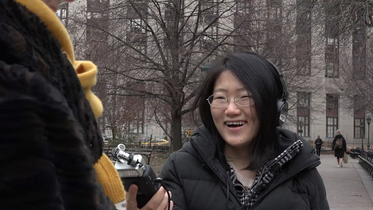 Reporter interviewing a subject in a park