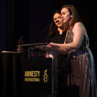 Claire Tighe and Lauren Gurley accept their Amnesty International Award