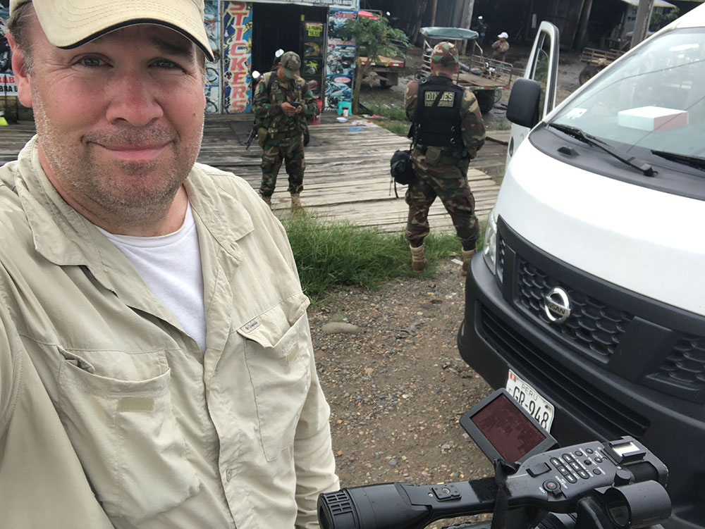 Professor Maloney films in Madre de Dios with police escort