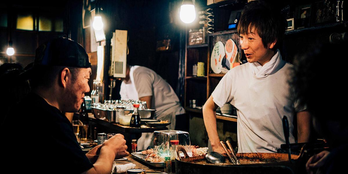 Restaurant worker talks with a patron