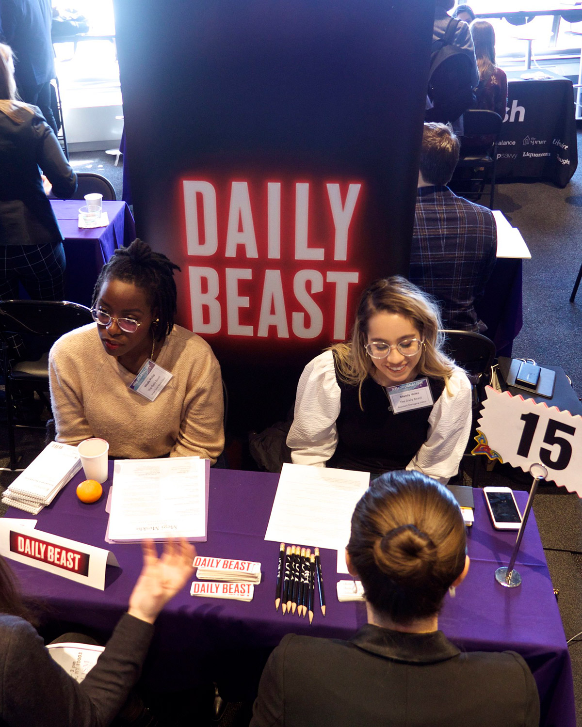 People at a Daily Beast booth at Career Fair 2020