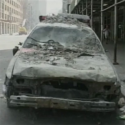 9/11 Coverage - Police car covered in ash