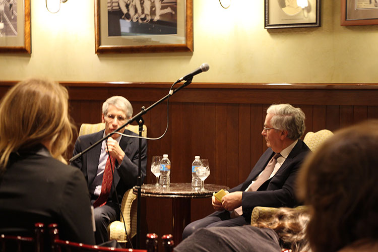 Lord Mervyn King (right), former Governor of the Bank of England during the financial crisis of 2008 and beyond, prepares to answer a question from a member of the audience.