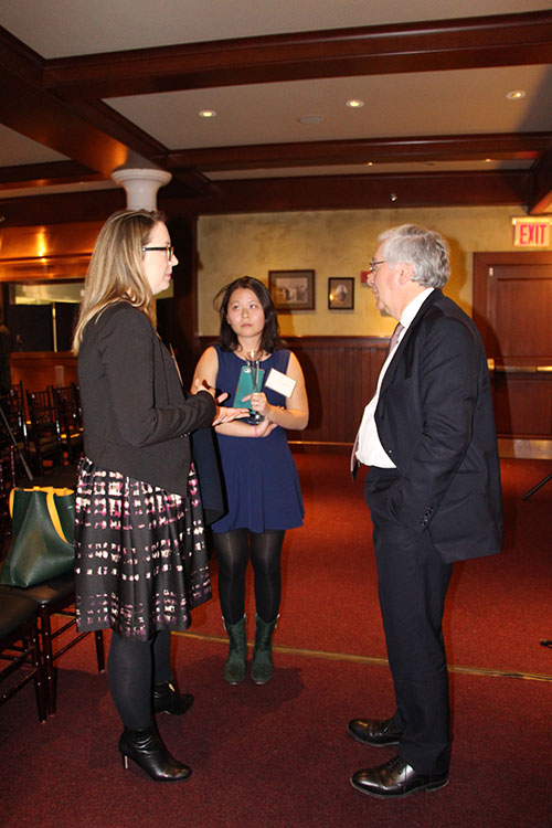 Lord Mervyn King talks with BER alumni after his lecture.