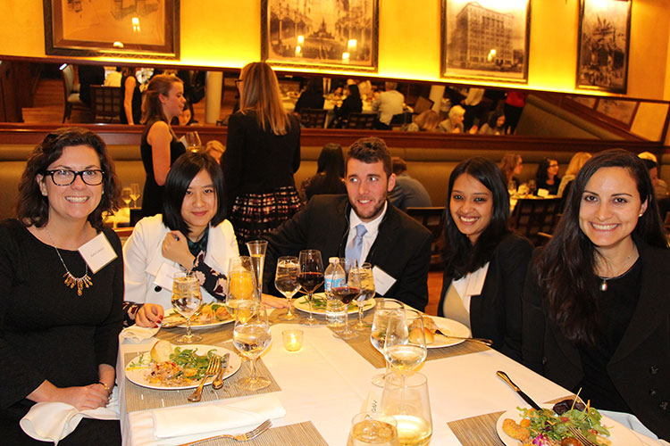 Students and alumni at the dinner after the talk.